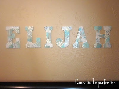 name on nursery wall