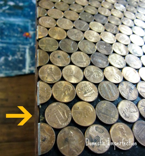 bending pennies around edge of corner