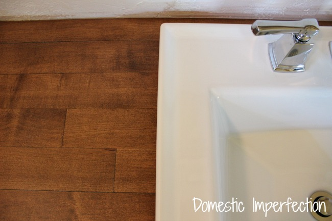 Rustic wood countertop and modern fixtures