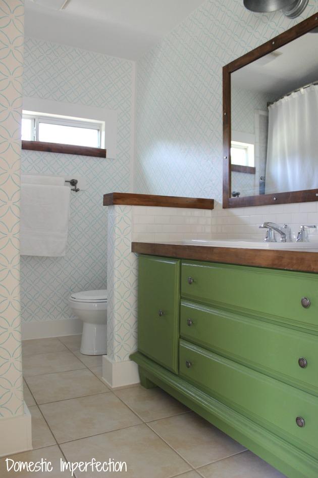 Bathroom remodel progress - dresser turned vanity, wooden accents, turquoise stencil