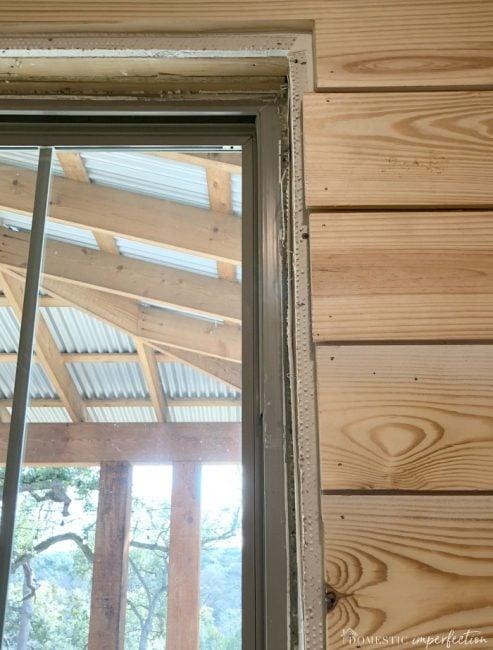 window trim over shiplap